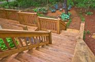 bigstock Wood Stairway To Landscaped Ya 8248661